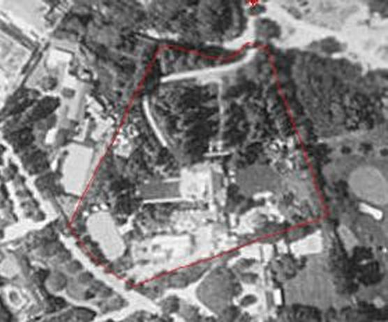 black and white playboy mansion aerial photo
